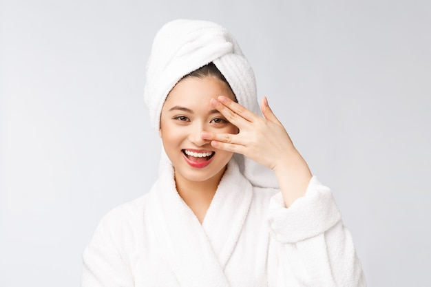 Spa skincare beauty asian woman drying hair with towel on head after shower treatment beautiful multiracial young girl touching soft skin
