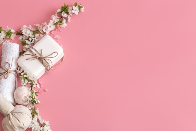 Spa still life on pink background with spring flowers