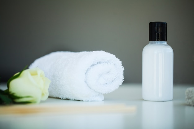 Spa still life with blossoms of white rose and essential oils