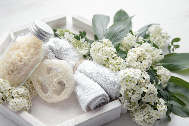 Spa still life with health and body care products, loofah and sea salt.