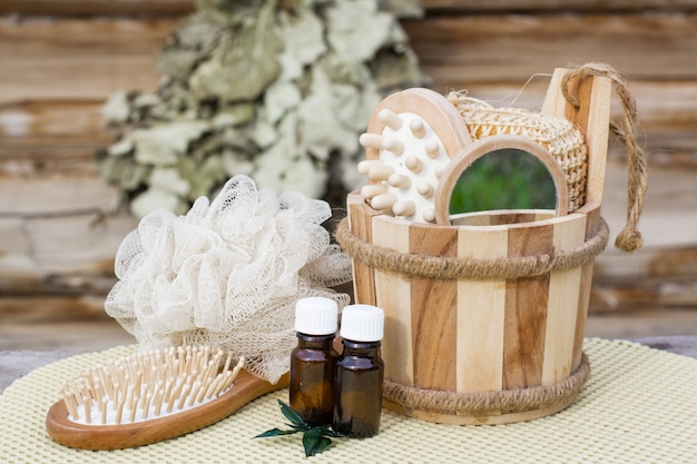 Spa still-life with objects for swimming against the background of a wooden log house