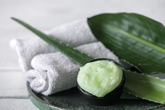 Spa still life with organic skincare, natural leaves and towels. the concept of beauty and organic cosmetics.