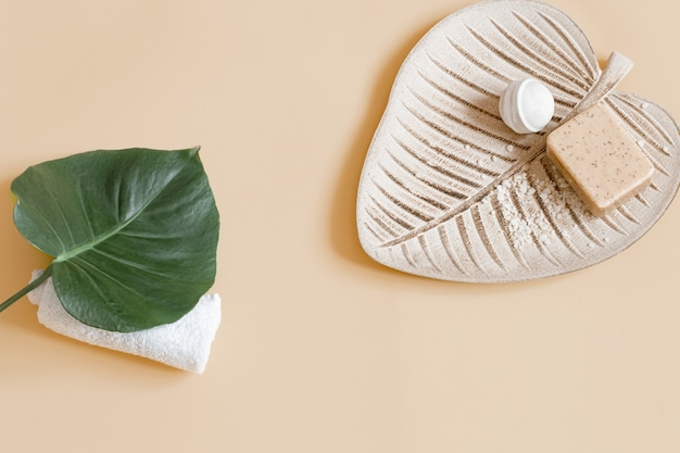 Spa still life with soap, bath bomb and leaf copy space. health and beauty concept.