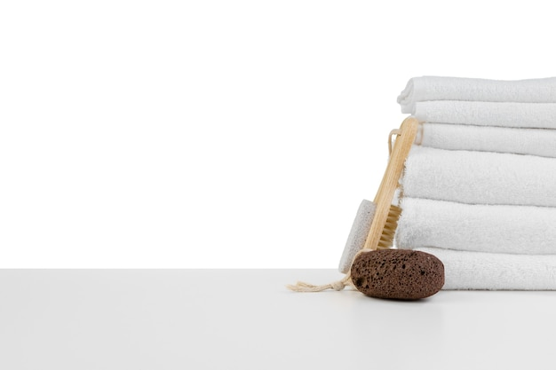 Spa still life with stacked of stone and towel isolated on white