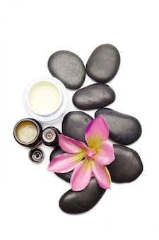 Spa stones and orchid flowers isolated on white