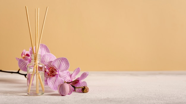 Spa therapy with flowers and scented sticks