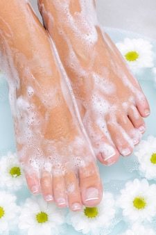 Spa treatment of a beautiful female feet in water