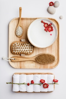 Spa treatment concept, flat lay composition with natural cosmetic products and massage brushes