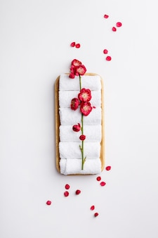 Spa treatment concept, flat lay composition with towels and flowers