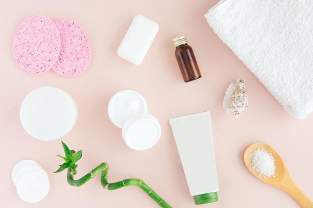 Spa treatment on pink, flat lay