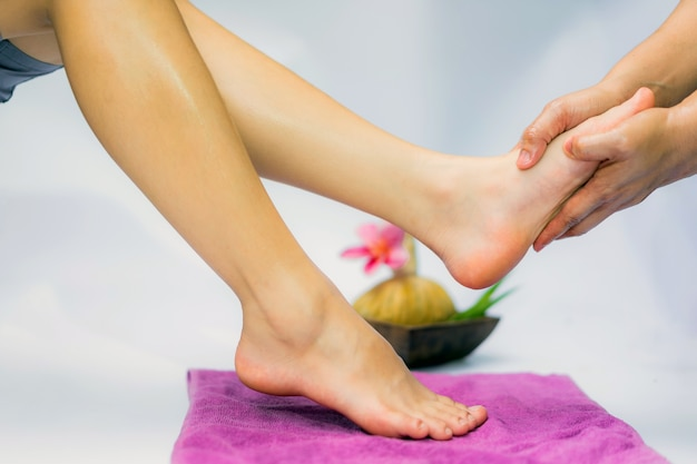 Spa treatment and product for feet spa with flowers; select and soft focus.