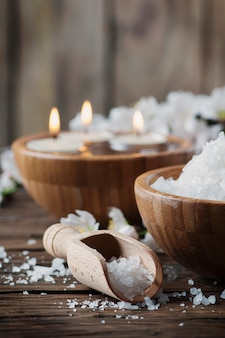 Spa treatment with salt, almond and candles