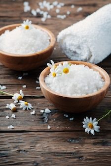 Spa treatment with salt and daisy