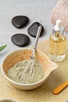 Spa and wellness composition with serum, towels and beauty products