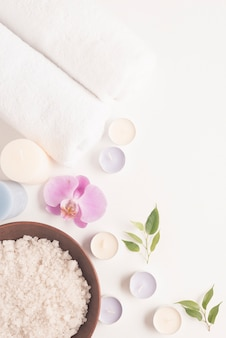 Spa wellness setting with sea salt in bowl