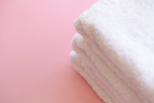 Spa. white cotton towels use in spa bathroom on pink .