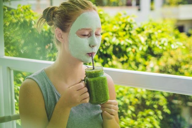 Spa woman applying facial green clay mask