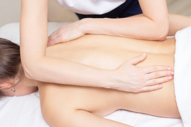 Spa woman body massage with hands treatment.