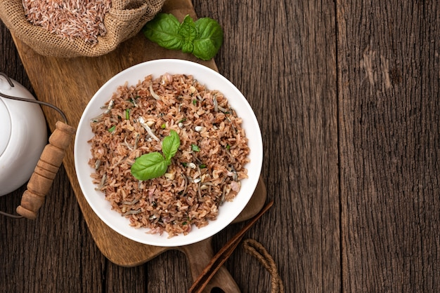 Space brown fire rice with dried chirimen fish on wood