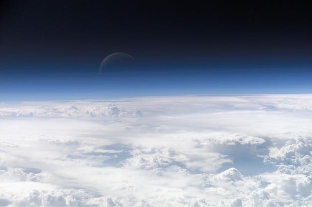 Space clouds atmosphere travel moonrise moon
