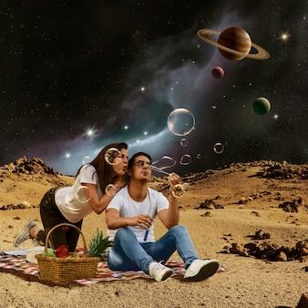 ピクニックをしている若い大人との宇宙コラージュ