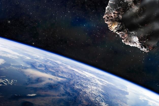 우주, 운석, 환상, 삽화. 운석이 행성에 접근하고 있습니다. nasa에서 제공한 이 이미지의 요소