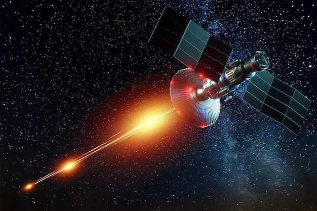 Космический военный спутник, оружие в космосе, стреляет лазером по стене земли. атака, технологии, космическая война. смешанная среда, копия пространства. изображение предоставлено наса.
