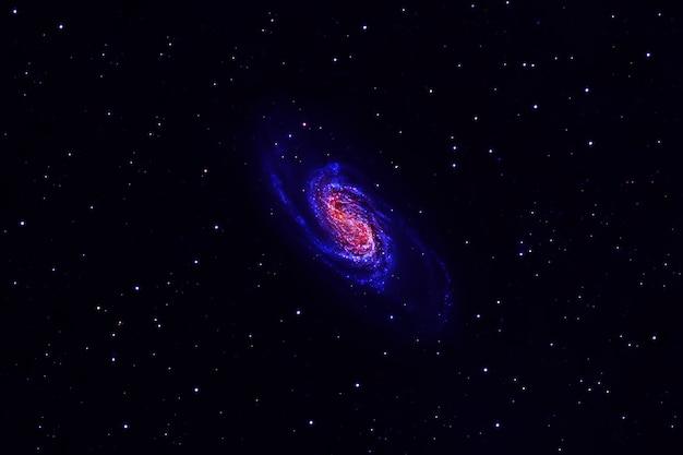 Космическая туманность синим цветом. голубое пространство со звездами. элементы этого изображения были предоставлены наса. фото высокого качества