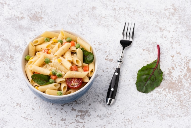 Space pasta with vegetable and cheese on isolated white