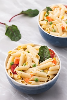 Space pasta with vegetable and cheese