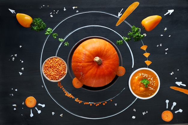 Space pumpkin solar system with orange vegetables, flat lay concept of healthy food