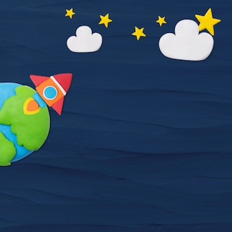 Space rocket textured background in blue plasticine clay craft for kids