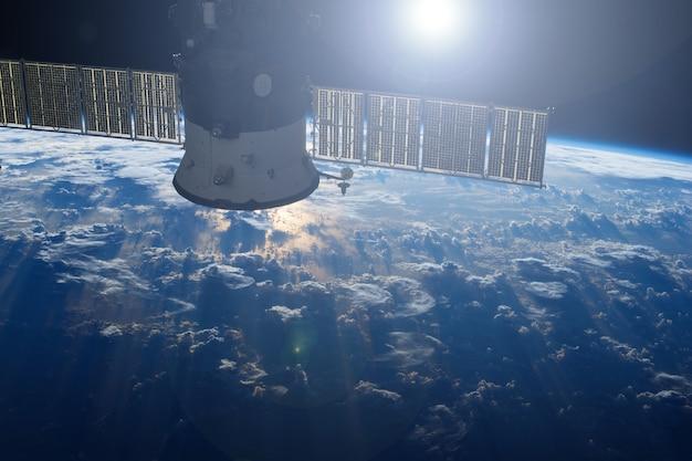 Космический спутник над землей элементы этого изображения предоставлены наса.