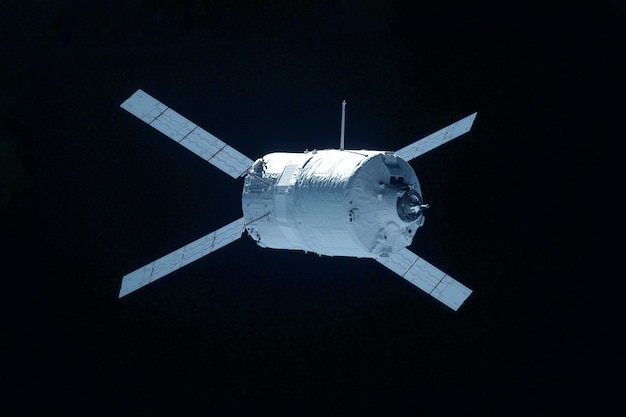 Space satellite isolated on a black background. elements of this image were furnished by nasa. for any purpose.