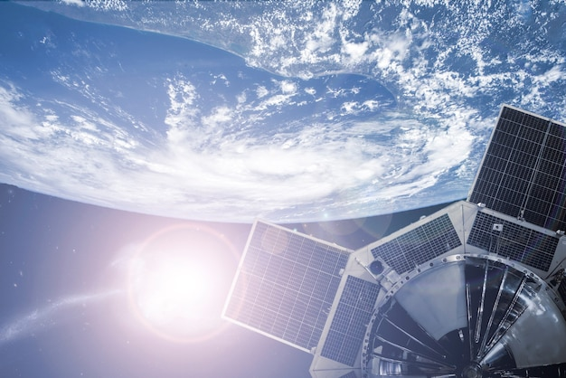 Space satellite in outer space orbiting the earth. elements of this image furnished by nasa ãƒâã'â°