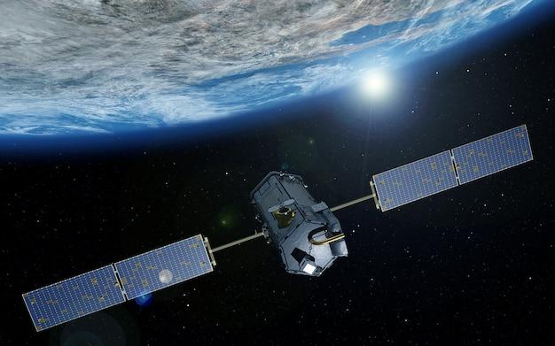 Космический спутник над планетой земля. элементы этого изображения предоставлены наса.