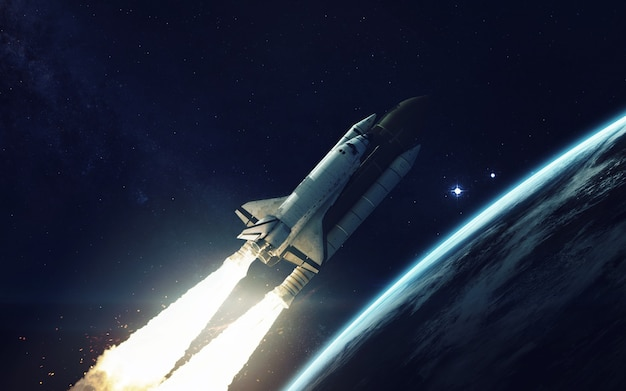 Space shuttle orbiting earth planet