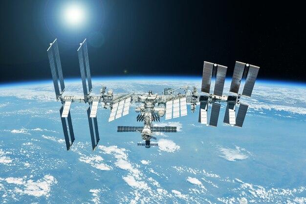 Космическая станция над землей. элементы этого изображения были предоставлены наса. фото высокого качества