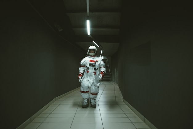 Spaceman in a futuristic station. man with space suit leaving for work and getting the train