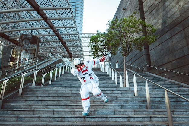 Spaceman in a futuristic station man with space suit walking in an urban area