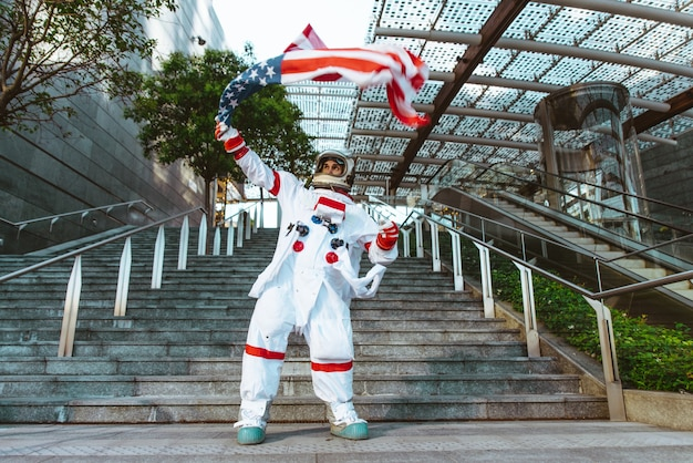 Spaceman in a futuristic station. man with space suit walking in an urban area