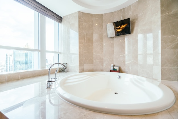 Spacious bathtub next to a window