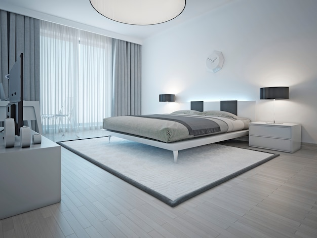 Spacious contemporary style bedroom with white carpet and light grey walls and furniture.