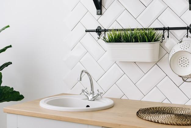 Spacious modern scandinavian loft kitchen with white tiles. bright room. modern interior.