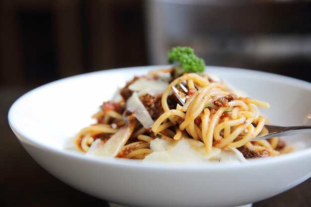 Spaghetti bolognese meat sauce on wood