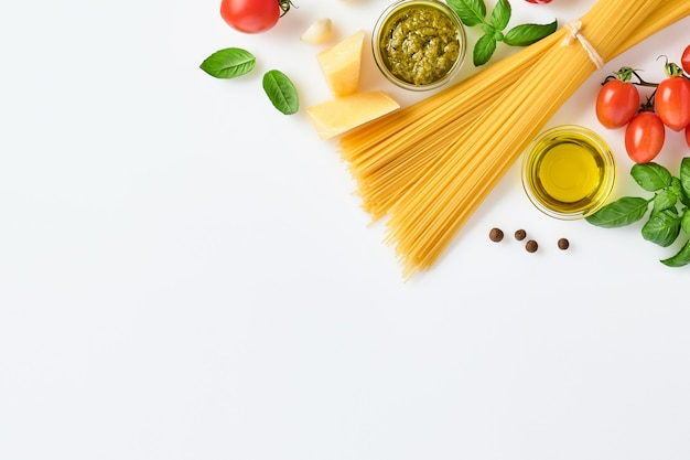Spaghetti, fresh tomato, herbs and spices. composition of healthy food ingredients isolated on white background, top view. mock up.