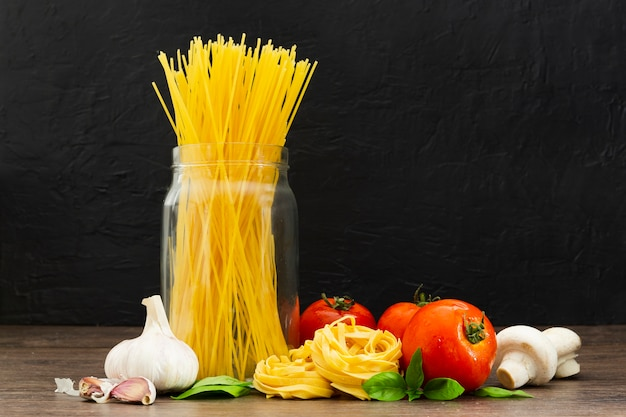 Spaghetti in jar with tomatoes and garlic