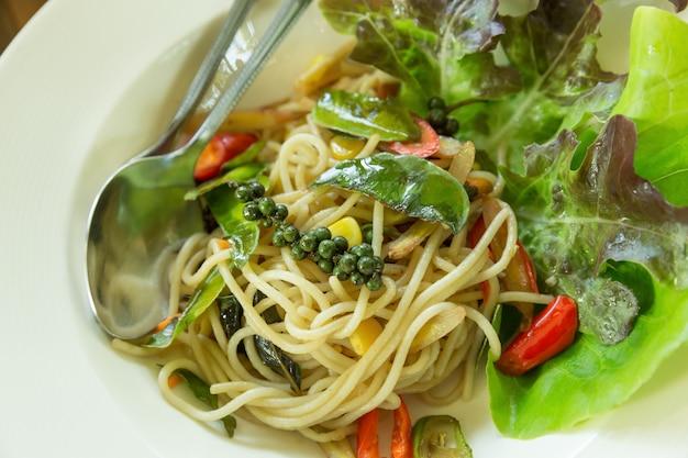 Spaghetti noodles on white plate