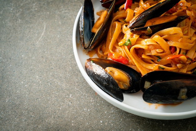 Spaghetti pasta with mussels or clams and tomato sauce - italian food style