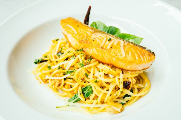 Spaghetti and pasta with salmon fillet meat